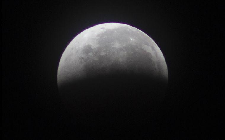 Moon leaves Earth's shadow