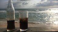Coke and ocean at Wijaya beach